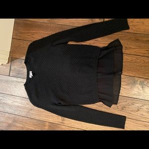 Black sweater with ruffle detail